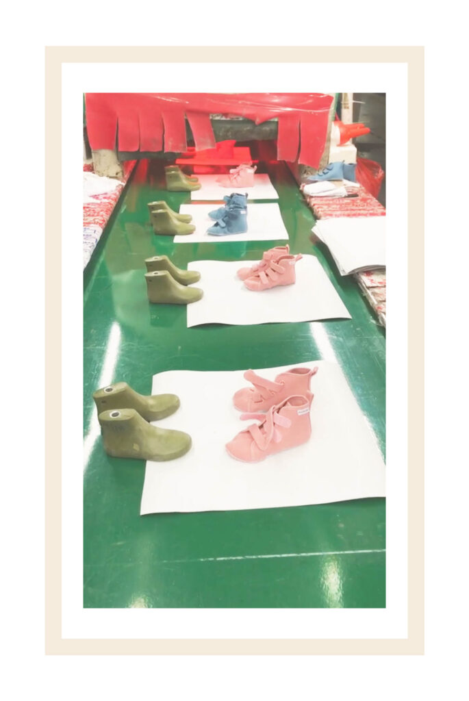 Piccolini pink kids shoes during the production line at the factory